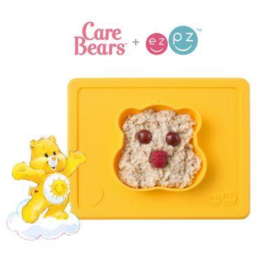 EZPZ - Silikonowa Miseczka z Podkładką 2w1 Care Bears™ Bowl Misia Słoneczne Serce Funshine Bear Żółta